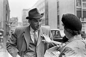 Jeremy Thorpe arriving at the Old Bailey for trial on charges of conspiracy to murder Norman Scott, London 1979 Red Cross charity worker pinning a badge onto his lapel - Martin Mayer - 09-05-1979