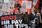 TGI Fridays fair pay and fair tips strike, Covent Garden, London - Jess Hurd - 2010s,2018,campaign,campaigning,CAMPAIGNS,catering,Covent Garden,DISPUTE,DISPUTES,EARNINGS,fair,fair pay,fair tips,FEMALE,Garden,GARDENS,Income,INDUSTRIAL DISPUTE,inequality,living wage,London,low pay