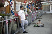 East End street party for the Royal wedding of Prince Harry and Meghan Markle, London - Jess Hurd - 2010s,2018,2nd,ACE,BAME,BAMEs,Black,BME,bmes,boy,boys,bunting,child,CHILDHOOD,children,cities,City,culture,DAD,DADDIES,DADDY,DADS,diversity,East End,Elizabeth,ethnic,ethnicity,families,family,father,F