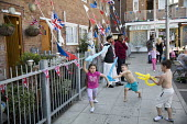 East End street party for the wedding of Prince Harry and Meghan Markle. - Jess Hurd - 2010s,2018,2nd,ACE,asian,asians,BAME,BAMEs,Black,black and white,BME,bmes,boy,boys,bunting,child,CHILDHOOD,children,cities,City,culture,DAD,DADDIES,DADDY,DADS,diversity,East End,Elizabeth,ethnic,ethni