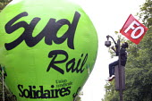 Paris, France: Protest by railway workers against Macron privatisation of the French National Railways (SNCF) and removal of railway workers statute - Nicolas Tavernier - 2010s,2018,activist,activists,against,anti,Anti privatisation,Anti privatisation,anti privatization,balloon,balloons,BAME,BAMEs,Black,BME,bmes,CAMPAIGN,campaigner,campaigners,CAMPAIGNING,CAMPAIGNS,DEM