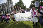 Protesting for abortion rights in Northern Ireland, Parliament Square, London - Jess Hurd - 2010s,2018,abortion,abortions,access,activist,activists,banner,banners,bodies,body,bound,campaigner,campaigners,CAMPAIGNING,CAMPAIGNS,DEMONSTRATING,demonstration,DEMONSTRATIONS,disabilities,disability