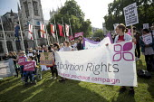 Protesting for abortion rights in Northern Ireland, Parliament Square, London - Jess Hurd - 2010s,2018,abortion,abortions,access,activist,activists,banner,banners,bodies,body,campaigner,campaigners,CAMPAIGNING,CAMPAIGNS,DEMONSTRATING,Demonstration,DEMONSTRATIONS,equal rights,equality,FEMALE,