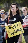 Protesting for abortion rights in Northern Ireland, Parliament Square, London - Jess Hurd - 2010s,2018,abortion,abortions,access,activist,activists,bodies,body,campaigner,campaigners,CAMPAIGNING,CAMPAIGNS,DEMONSTRATING,demonstration,DEMONSTRATIONS,equal rights,equality,FEMALE,feminism,femini