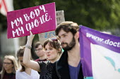 Protesting for abortion rights in Northern Ireland, Parliament Square, London. - Jess Hurd - 2010s,2018,abortion,abortions,access,activist,activists,bodies,body,campaigner,campaigners,CAMPAIGNING,CAMPAIGNS,DEMONSTRATING,demonstration,DEMONSTRATIONS,equal rights,equality,FEMALE,feminism,femini