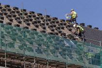 Roofers putting tiles onto new housing, Stratford upon Avon, Warwickshire - John Harris - 11-06-2018