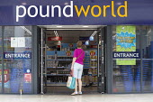 Shoppers at Poundworld which has announced it has gone into administration with 5,100 jobs at risk. When It's Gone It's Gone advertismanr in the window - John Harris - 2010s,2018,administration,adult,adults,bag,bags,bankrupt,bankruptcy,bought,Business,buying,cities,City,CLOSED,closing,closure,closures,commodities,commodity,consumer,consumers,couple,COUPLES,Coventry,