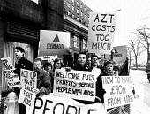 Peter Tatchell protest Wellcome plc AGM AIDS profits from the high cost of AZT anti Aids drug, London - Stefano Cagnoni - 1980s,1989,Act Up,AIDS,anti Aids drug,antiretroviral,antiretrovirals,antiviral,antivirals,AZT,companies,company,Demonstration,drug,drugs,Gay,gays,HIV,HIV/AIDS,homosexual,homosexuals,ill,illness,Infect