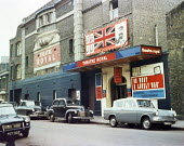 Theatre Royal Stratford East, 1963. Billboards showing Theatre Workshop production of Oh What A Lovely War! directed by Joan Littlewood, London - Romano Cagnoni