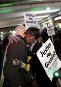 Hugging a firefighter, Justice for Grenfell six month anniversary silent walk, Kensington and Chelsea, London - Jess Hurd - 2010s,2017,activist,activists,adult,adults,anniversary,BAME,BAMEs,Black,Black and White,BME,bmes,CAMPAIGNING,CAMPAIGNS,DEATH,DEMONSTRATING,Demonstration,diversity,EMBRACE,EMBRACING,emotion,emotional,e