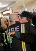 Hugging a firefighter, Justice for Grenfell six month anniversary silent walk, Kensington and Chelsea, London - Jess Hurd - 14-12-2017