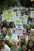 Silent march in memory of the victims of Grenfell Tower fire on the first anniversary, Kensington, London - Jess Hurd - 1st,2010s,2018,activist,activists,anniversary,CAMPAIGNING,CAMPAIGNS,COMMEMORATE,commemorating,commemoration,COMMEMORATIONS,commemorative,DEMONSTRATING,demonstration,fire,fires,first,green,heart shape,