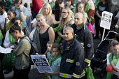 Silent march in memory of the victims of Grenfell Tower fire on the first anniversary, Kensington, London - Jess Hurd - 1st,2010s,2018,activist,activists,adult,adults,anniversary,BAME,BAMEs,Black,Black and White,BME,bmes,CAMPAIGNING,CAMPAIGNS,COMMEMORATE,commemorating,commemoration,COMMEMORATIONS,commemorative,DEMONSTR