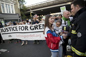 Local community thanking the firefighters. Silent march in memory of the victims of Grenfell Tower fire on the first anniversary, Kensington, London - Jess Hurd - 1st,2010s,2018,activist,activists,adult,adults,anniversary,banner,banners,CAMPAIGNING,CAMPAIGNS,child,CHILDHOOD,children,COMMEMORATE,commemorating,commemoration,COMMEMORATIONS,commemorative,communitie