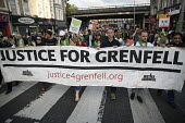 Silent march in memory of the victims of Grenfell Tower fire on the first anniversary, Kensington, London - Jess Hurd - 1st,2010s,2018,activist,activists,anniversary,banner,banners,CAMPAIGNING,CAMPAIGNS,COMMEMORATE,commemorating,commemoration,COMMEMORATIONS,commemorative,DEMONSTRATING,demonstration,fire,fires,first,gre