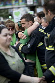 Local community thanking the firefighters. Silent march in memory of the victims of Grenfell Tower fire on the first anniversary, Kensington, London - Jess Hurd - 1st,2010s,2018,activist,activists,adult,adults,anniversary,CAMPAIGNING,CAMPAIGNS,COMMEMORATE,commemorating,commemoration,COMMEMORATIONS,commemorative,communities,community,cry,crying,DEMONSTRATING,dem
