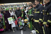 Local community thanking the firefighters. Silent march in memory of the victims of Grenfell Tower fire on the first anniversary, Kensington, London - Jess Hurd - 1st,2010s,2018,activist,activists,adult,adults,against,anniversary,BAME,BAMEs,Black,Black and White,BME,bmes,CAMPAIGN,campaigner,campaigners,CAMPAIGNING,CAMPAIGNS,child,CHILDHOOD,children,COMMEMORATE,