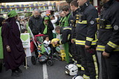 Local community thanking the firefighters. Silent march in memory of the victims of Grenfell Tower fire on the first anniversary, Kensington, London - Jess Hurd - 14-06-2018
