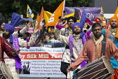 Silk Mill March, Derby. Remembering the workers locked out by the owners for joining a trade union in 1834. Bhangra dancers - John Harris - 2010s,2018,ACE,activist,activists,Arts,Asian,Asians,BAME,BAMEs,Black,BME,bmes,CAMPAIGNING,CAMPAIGNS,COMMEMORATE,COMMEMORATING,commemoration,COMMEMORATIONS,commemorative,Culture,dance,dancer,dancers,da