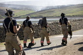Firefighters deployed to Saddleworth Moor fire, Stalybridge, Derbyshire - Jess Hurd - 2010s,2018,adult,adults,beater,beaters,country,countryside,Derbyshire,DIA,Emergency Services,employee,employees,Employment,FEMALE,fire,Fire and Rescue,Fire and Rescue Service,fire brigade,Firefighter,