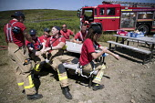 Green watch, Lancashire firefighters applying sun lotion, Fire and Rescue deployed to Saddleworth Moor fire, Stalybridge, Derbyshire - Jess Hurd - 2010s,2018,adult,adults,applying,break,break time,breaktime,Derbyshire,DIA,Emergency Services,employee,employees,Employment,fire,Fire AND Rescue,Fire and Rescue Service,Fire Brigade,Fire Engine,Firefi
