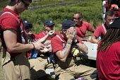 Green watch, Lancashire firefighters applying sun lotion, Fire and Rescue deployed to Saddleworth Moor fire, Stalybridge, Derbyshire - Jess Hurd - 2010s,2018,adult,adults,applying,break,break time,breaktime,Derbyshire,DIA,Emergency Services,employee,employees,Employment,fire,Fire AND Rescue,Fire and Rescue Service,Fire Brigade,Firefighter,firefi