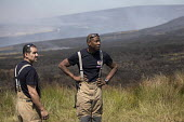 Firefighters deployed to Saddleworth Moor fire, Stalybridge, Derbyshire - Jess Hurd - 2010s,2018,adult,adults,BAME,BAMEs,Black,Black and White,BME,bmes,Derbyshire,destroyed,destruction,DIA,diversity,Emergency Services,employee,employees,Employment,ethnic,ethnicity,fire,Fire and Rescue,