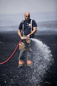 Firefighters deployed to Saddleworth Moor fire, Stalybridge, Derbyshire - Jess Hurd - 2010s,2018,adult,adults,burn,burning,BURNS,Derbyshire,destroyed,destruction,DIA,Emergency Services,employee,employees,Employment,fire,Fire and Rescue,Fire and Rescue Service,fire brigade,Firefighter,f