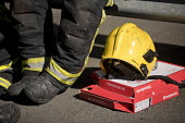 Exhausted firefighters from White Watch taking a break with gifted Domino's pizza as Grafton House twelfth floor fire is contained and brought under control by over 50 firefighters at a 22 story East... - Jess Hurd - 29-06-2018