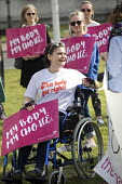 Protesting for abortion rights in Northern Ireland, Parliament Square, London - Jess Hurd - 2010s,2018,abortion,abortions,access,activist,activists,bodies,body,bound,campaigner,campaigners,CAMPAIGNING,CAMPAIGNS,DEMONSTRATING,demonstration,DEMONSTRATIONS,disabilities,disability,disable,disabl