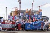 Unions and Keep Our NHS Public NHS 70th anniversary protest outside the unfinished Midland Metropolitan Hospital, construction of which stopped when Carillion went into liquidation - John Harris - 2010s,2018,activist,activists,anniversary,Birmingham,birthday,BIRTHDAYS,building,building site,buildings,CAMPAIGNING,CAMPAIGNS,Community Union,DEMONSTRATING,Demonstration,FEMALE,Health Campaigns Toget