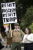 Protest against Donald Trump visiting the UK, Regents Park, London - Jess Hurd - 2010s,2018,activist,activists,against,anti,Anti Fascist,Anti Racism,anti racist,CAMPAIGNING,CAMPAIGNS,DEMONSTRATING,Demonstration,DEMONSTRATIONS,Donald Trump,London,placard,placards,Protest,PROTESTER,