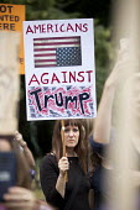 Protest against Donald Trump visiting the UK, Regents Park, London - Jess Hurd - 2010s,2018,activist,activists,against,american,americans,anti,CAMPAIGN,campaigner,campaigners,CAMPAIGNING,CAMPAIGNS,DEMONSTRATING,Demonstration,DEMONSTRATIONS,Donald Trump,flag,flags,London,placard,pl