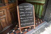 Drag Protest sign outside the Lyric Pub Together Against Trump protest against the visit to the UK by the US President Donald Trump, London - Jess Hurd - 2010s,2018,activist,activists,Against,blackboard,BLACKBOARDS,CAMPAIGNING,CAMPAIGNS,communicating,communication,DEMONSTRATING,demonstration,Donald Trump,Drag,drag queens against Trump,equal,Gay,gays,ho