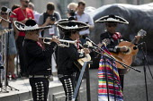 Mariachi band playing, Together Against Trump protest against the visit to the UK by US President Donald Trump, London - Jess Hurd - 2010s,2018,ACE,activist,activists,Against,Arts,band,bands,CAMPAIGNING,CAMPAIGNS,Culture,DEMONSTRATING,demonstration,Donald Trump,hat,hats,Hispanic,Hispanics,latino,latinos,London,marching,Mariachi ban