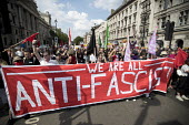 Anti fascists counter protest against pro Trump and Tommy Robinson protest, Whitehall, London - Jess Hurd - 2010s,2018,activist,activists,against,anti,Anti Fascist,Anti fascists,BAME,BAMEs,banner,banners,Black,Black and White,BME,bmes,CAMPAIGNING,CAMPAIGNS,counter,DEMONSTRATING,demonstration,DEMONSTRATIONS,