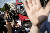 Pro Trump and Tommy Robinson supporters blocking a bus intimidating a Muslim women driver, Whitehall, London - Jess Hurd - 2010s,2018,activist,activists,Anti fascists,bigotry,block,blockade,blockading,blocking,blocks,bus,bus service,BUSES,CAMPAIGN,campaigner,campaigners,CAMPAIGNING,CAMPAIGNS,DEMONSTRATING,demonstration,DE