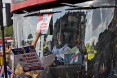 Pro Trump and Tommy Robinson supporters blocking a bus intimidating a Muslim women driver, Whitehall, London - Jess Hurd - 2010s,2018,activist,activists,Anti fascists,BAME,BAMEs,bigotry,Black,Black and White,block,blockade,blockading,blocking,blocks,BME,bmes,bus,bus service,BUSES,CAMPAIGN,campaigner,campaigners,CAMPAIGNIN