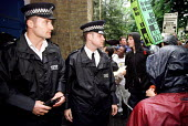 Policing a protest by pupils and teachers at Kingsland School, outside a disiplinary hearing of 24 teachers who went on unofficial strike in defence of Mathematics teacher Indro Sen NUT rep, Hackney,... - Jess Hurd - 10-07-2000