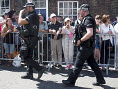 Armed police on the streets, Durham Miners Gala, 2018 - Mark Pinder - 2010s,2018,adult,adults,armed,Armed Forces,CLJ,confidence patrol,Counter Terrorism Unit,Counter Terrorist Specialist Firearms Officer,County Durham,CTSFO,DMA,Durham Miners Gala,Durham Miners' Gala,fir