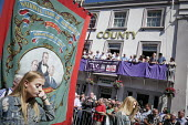 Banners pass balcony of The County Hotel, Durham Miners Gala, 2018 - Mark Pinder - 2010s,2018,banner,banners,County Durham,DMA,Durham Miners Gala,Durham Miners' Gala,Hotel,HOTELS,Jeremy Corbyn,Labour Party,member,member members,members,MINER,Miners,MINER'S,MP,MPs,NUM,parade,politici