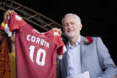 Jeremy Corbyn presented with a 'Marras' Friends of the Gala football shirt, Durham Miners Gala, 2018 - Mark Pinder - 2010s,2018,County Durham,DMA,Durham Miners Gala,Durham Miners' Gala,football,Friends,Jeremy Corbyn,Labour Party,member,member members,members,MINER,Miners,MINER'S,MP,MPs,NUM,politician,politicians,shi