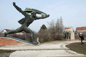 Visitor taking photographs of Soviet era statues relocated to Memento Park Museum, Budapest, Hungary - Janina Struk - 02-01-2014