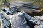 Disgarded Soviet era statues, including one of Lenin, laying outside Memento Park Museum Budapest, Hungary - Janina Struk - 2010s,2014,ACE,art,arts,artwork,artworks,CCCP,communism,Communist Party,communists,culture,disgarded,Eastern Europe,fall,fall of communism,fallen,falls,hero,heroes,heroic,historical,history,Hungary,ic