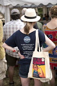 NEU T-shirt at Tolpuddle Martyrs' Festival, Dorset 2018. - Jess Hurd - 2010s,2018,COMMEMORATE,COMMEMORATING,commemoration,COMMEMORATIONS,commemorative,Dorset,equal rights,equality,FEMALE,feminism,feminist,feminists,Festival,festivals,icon,iconic,iconography,member,member