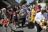 Jeremy Corbyn wreath laying at Tolpuddle Martyrs' Festival, Dorset 2018. - Jess Hurd - 2010s,2018,COMMEMORATE,COMMEMORATING,commemoration,COMMEMORATIONS,commemorative,Dorset,FEMALE,Festival,festivals,floral tribute,floral tributes,flower,flowering,flowers,Jeremy Corbyn,Labour Party,layi