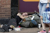 Homeless youth sleeping in the street during a heatwave, Stratford Upon Avon, Warwickshire - John Harris - 2010s,2018,asleep,bag,bags,doorway,excluded,exclusion,exhausted,exhaustion,HARDSHIP,heat,homeless,homelessness,hot,impoverished,impoverishment,INEQUALITY,male,man,Marginalised,men,pedestrian,pedestria