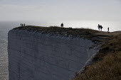 Tourists at Beachy Head, a Chalk headland and suicide spot in East Sussex - Jess Hurd - 2010s,2018,attraction,Beachy Head,Chalk,cliff,cliffs,COAST,coastal,coasts,committed,committing,country,countryside,East Sussex,edge,eroded,erosion,FEMALE,headland,height,high up,holiday,holiday maker,