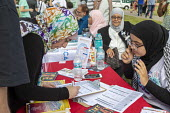 Dearborn, Michigan USA: Woman registering to vote, Muslim Get Out the Vote rally, sponsored by several Muslim community organisations - Jim West - 29-07-2018