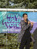 Dearborn, Michigan USA: Alexandria Ocasio-Cortez DSA speaking, Muslim Get Out the Vote rally, sponsored by several Muslim community organisations - Jim West - DSA,2010s,2018,Alexandria Ocasio-Cortez,America,BAME,BAMEs,Belief,BME,bmes,CAMPAIGN,campaigning,CAMPAIGNS,candidate,CANDIDATES,communities,community,Congress,conviction,Dearborn,DEMOCRACY,Democratic P
